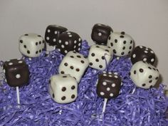 Dice cake pops... I love the contrast of the black dice thrown in.