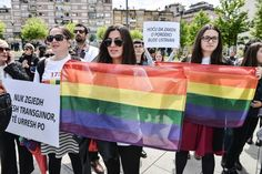 Activists of the #LGBT community hold rainbow flags as they demonstrate through the main square in #Pristina on May 17, 2016, as part of a first #GayPride parade to seek acceptance and respect of their rights in a conservative society.