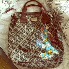 I just discovered this while shopping on Poshmark: Ed hardy tote. Check it out!  Size: OS