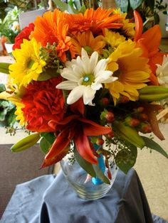 I love this warm color combination. It would be perfect for a fall wedding. Bridal Bouquet by Rodeo Plaza Flowers & Gifts. If you are looking for a florist in Santa Fe Contact them today!