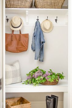A simple mudroom exudes character and charm in this young family's modern farmhouse.