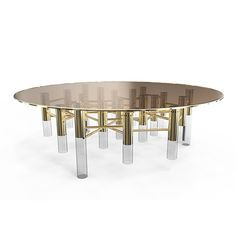 Ike Center Table features a brown glass top with a gold trim, three neat Gold Plated and Glossy Black legs are firmly kept in place by a set of brass tubes in a beautiful composition.