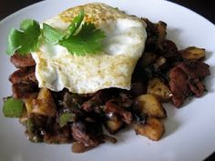 Sausage Hash and Fried Egg (paleo) with sweet potatoes, chorizo, red onion, bell pepper, cilantro