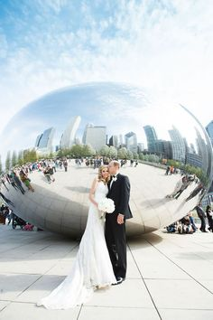 The city of Chicago is a part of this couple's history—so it's only fitting that their vows took place on Chicago's gorgeous lakefront at the Adler Planetarium. Photography by Maypole Studios.