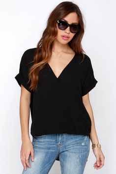 "Top the charts with the applause-worthy Wrap Star Black High-Low Top! This woven Georgette top has short rolled sleeves, and a straight-cut bodice, plus a sweet surplice front that loops at bottom. A high-low hem and back box-pleated detail offer a light and feminine look. Unlined. Top measures 7.5"" longer at back. 100% Polyester. Dry Clean Only. Made With Love in the U.S.A."