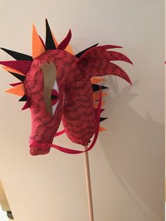 Handmade Hobby Horse Dragon - Fire  This is a handmade Hobby Horse for a girl or boy. My horses are all unique and made with love for a childs imaginary play!  Fire is red black and orange with a splash of bronze in colour. He has red ears and a felt black red and orange spikes. The perfect gift for that special child or toddler.  Care has been taken to sew all of the items as tight as possible to ensure minimal breakage from little fingers!  My kids love the ones I have made for them I am…