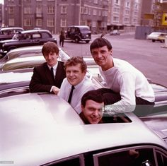 English Merseybeat pop group The Fourmost posed sitting on and in a car in From left to right: Billy Hatton, Mike Millward, Dave Lovelady and Brian O'Hara. Get premium, high resolution news photos at Getty Images Pop Group, Liverpool, English, Poses, Couple Photos, Celebrities, Classic, Image, Gallery