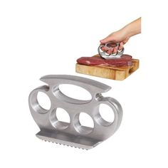 """Give your meat a punch! Get out that pent-up aggression while preparing your meat with this cool Kuckle Pounder Meat Tenderizer. Looks just like traditional brass knuckles but instead of """"knuckles"""" there is a tenderizer grid. Its made of heavy aluminum alloy and its grooves make it easy to hold and pound the meat. Now what are you waiting for? Pound it out!."""