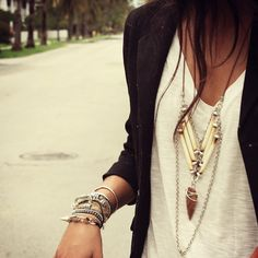 Black cardi over white tee with layered necklaces and bracelets
