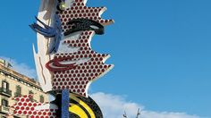 Here is the Barcelona Face done by Roy Lichtenstein by Port Vell. Lichtenstein created this structure as a tribute to the Olympics and Gaudí himself. The tiling here reminds me of the dragon done in Parc Güell in that Lichtenstein like Gaudí utilized colorful tiles to create a considerable figure.