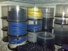 Clever way to organize all those cables you have laying around... especially if you go through CDs and DVDs like my hubby does...