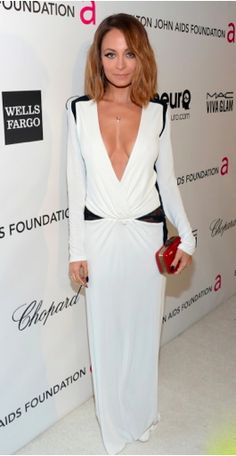 Nicole Richie with an adorable House of Harlow Clutch!