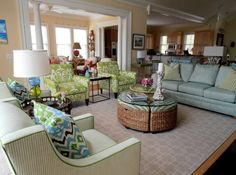 Beach House in South Carolina  Arear rug, additional seating under the coffee table, bunching ottoman, club chairs colorful pillows, green, blue