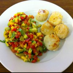 One of my favorite summer meals to make. Scallops and a salad of: avocado, tomato, red pepper, mango and cilantro. Salad dressing is olive oil, lime juice, salt, pepper and a dash of sugar. The scallops are pan seared in olive oil and garlic with some salt and pepper but you could grill them too or season them with some other spices. It's healthy too!