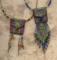 Heidi Kummli, I like beaded pouches, but I never understand how these smaller ones are functional? neat idea.