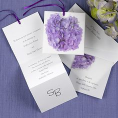 A white z-fold invitation insert tucks away perfectly into this translucent pocket featuring a purple hydrangea on the front. The insert has a pre-cut ribbon in the color of your choice: lemon, black, white, silver, blush, magenta, bay, breeze, navy, purple, olive, sage, orange, ginger, claret, mocha, or passion.