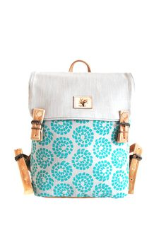 A trendy backpack with leather finishes to fit longer items such as books and magazines and other clothing. Trendy Backpacks, Hermes Kelly, Luggage Bags, Pepper Tree, African, Turquoise, Leather, Black People, Teal