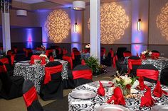 black white & red table decor and linen  with black chair covers w/ red sashes