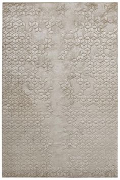 """ Helen Amy Murray Star Silk is hand knotted from silk, and the motif is then carved into the surface by hand. This rug is entirely handmade, from the spinning of the yarns to the weaving on the loom...."