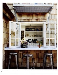 Outdoor or pool bar. Hidden in secret window area & bar with stools