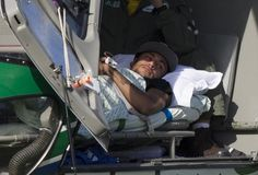 Brazil's Neymar lies inside a medical helicopter at the Granja Comary training center, in Teresopolis, Brazil, Saturday, July 5, 2014. Neymar was airlifted from Brazil's training camp Saturday and will be treated at home for his back injury. Neymar, the biggest football star in Brazil, was ruled out of the rest of the World Cup after fracturing his third vertebra during Friday's 2-1 quarterfinal win over Colombia.