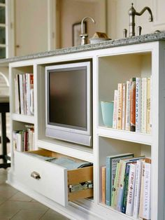 I don't know who would put a TV in an island, but I like the idea of extra storage in one.