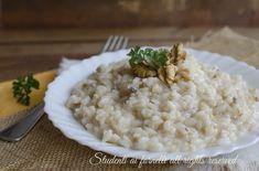 Risotto gorgonzola e noci cremoso, ricetta primo piatto facile e veloce da preparare. Risotto ai formaggi e noci