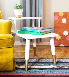If you want to try your hand at restoring vintage furniture, a $10 Craigslist find like this midcentury side table is a low-risk move. With several coats of paint and iron-on veneer edging, Sarah of Sarah Hearts transformed her inexpensive retro purchase into a glamorous gold-dipped accent piece.