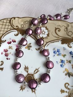 Beautiful damson coloured Murano glass smartie beads, all individually handmade with sterling silver inside. Sterling silver beads and clasp too. www.dianaingram.com
