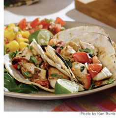 Chicken and Charred Tomato Tacos-cook your tomatoes in a cast-iron skillet for smoky, sensational results.