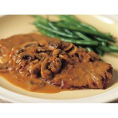 Veal scallopini with mushroom sauce recipe - By Australian Women's Weekly, A classic Italian recipe, veal scallopini, the tender thinly sliced veal is served here with a creamy mushroom sauce.