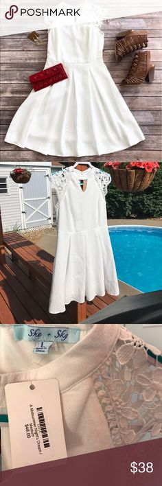 Little White Dress Ordered this dress from a cute boutique called Three Little Birds. Ordered a medium size and was sent a large. Flowy white dress with keyhole neckline and lace-y cap style sleeves! She and Sky Dresses Asymmetrical