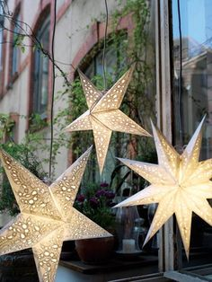 Star paper lanterns! Tons of these hanging from the ceiling would make a huge impact
