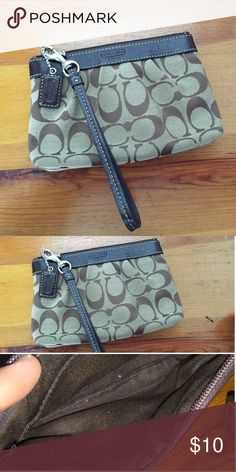 "Coach wristlet Leather and fabric Coach wristlet with brown leather fob/tag. Excellent condition, No tarnishing to the hardware or damage to the leather. Zipper closure. Interior and exterior are clean (just some lint in photo which I will make sure is gone before sending it out.) Approximate measurements 7"" x 4.5"" x 1.25"". Strap length approximately 6"" excluding lobster claw clasp. Coach Bags Clutches & Wristlets"