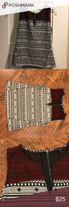 Black, red and white tribal print top Black and white top with tribal print. Red and black pattern at shoulders. Cute for work or dressed up for evenings. Worn once. Sanctuary Tops