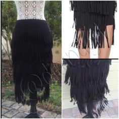 "✨💫HP✨💫SASSY FLIRTY FRINGE SKIRT Be awesome in this black fringe skirt! 4 full layers of 6"" fringe all the way around this beautiful fabric skirt, polyester/nylon/spandex blend, elastic banded waist, can be worn high on waist or lower on hip. Overall length to bottom fringe is 25 1/2"" approx. JS Signature Skirts"