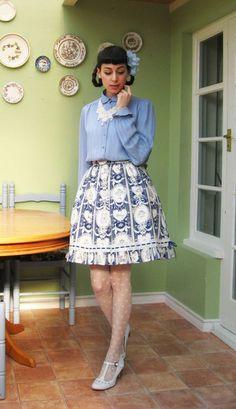 xsapphiradollx, in an elegant blue outfit.