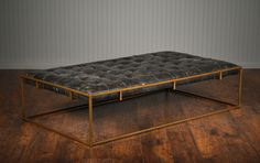 Tufted Leather Coffee Table Ottoman with Aged Brass Finished Frame  Also Available AsSquare Tufted Ottoman