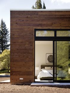 "The modestly scaled master bedroom opens to a view of the woods located behind the property. Tagged: Bedroom and Bed. Search ""street view"" from This Couple Achieves Their Glass House Goals. Browse inspirational photos of modern bedrooms. Home Design Decor, Home Decor, Exterior Design, Interior And Exterior, House Goals, Lofts, Interior Architecture, Sweet Home, New Homes"