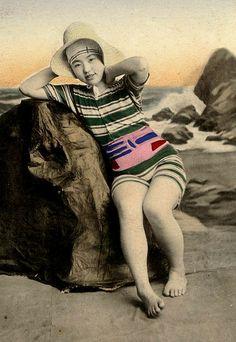 GEISHA ON A ROCK  --  Posing as a Bathing Beauty by Okinawa Soba, via Flickr