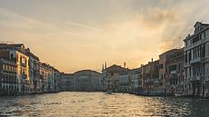 Scenic view on Venice Canal from boat. Copy space. Architecture gallery by Trent Lanz for Stocksy United - Royalty-Free Stock Photos. beautiful, blue, blue sky, building, calm, canal, city, copy space, day, destination, europe, gold, golden, historical, horizontal, italy, landmark, landscape, marine, melancholy, nautical, nobody, outdoors, peaceful, picturesque, ripple, scenery, scenic, seascape, seaview, sky, sunlight, sunset, tourism, town, tranquility, travel, venice, view, water