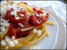 spaghetti con pomodoro confit e ricotta dura