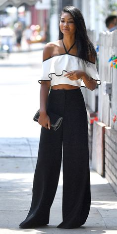 Chanel Iman knocked down the sweet (and sexy) factor by styling her ruffled cold-shoulder crop top with a sleek pair of wide-leg pants and a metallic clutch.