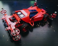 Red Enough? Rear suspension setup with a pretty cool roller :D :D :D