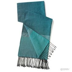 Teal Stripe Scarf  Gorgeous cotton scarf gets its deep color from teal threads handwoven with black weft threads, culminating in twisted black fringe on either end. Material has a subtle sheen. Hand wash. 72in. l x 24in. w Made in Cambodia $22