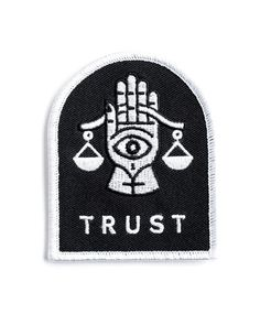 "The balance of trust is a delicate one. Embroidered patch on twill Merrowed edge Comes on custom foil-stamped packaging Measurements: 2.5"" x 3.25"" By Beeteeth"