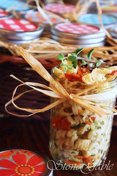 I must admit, I am a little jar crazy! Put food in a jar and I not only want to eat it but can't wait to make it. Pasta Salad In A Jar was ON THE MENU for the last picnic of the summer at StoneGable. Tying a raffia bow around the jar and fixing Salad In A Jar, Soup And Salad, Pasta Salad, Noodle Salad, Salad Bar, Summer Recipes, Great Recipes, Favorite Recipes, Side Recipes