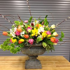 spring explosion designed by local color flowers filled with locally grown pussywillows, tulips, daffodils, anemones, ranunculus and bells of ireland