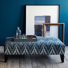 Probably too loud with the kilim, but I like the idea of mixing prints. Just has to be the right one...  Patchen Ottoman #WestElm