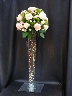 Battery powered fairy lights to fill the vase with pearls in the base. Cylinder Vase Centerpieces, Tall Cylinder Vases, Lighted Centerpieces, Quinceanera Centerpieces, Tall Wedding Centerpieces, Floral Centerpieces, Tall Centerpiece, Wedding Reception Table Decorations, Wedding Ideas
